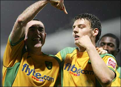 Chris Martin celebrates his winner for Norwich