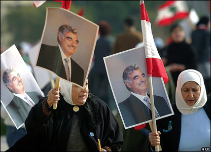 Lebanese women carry pictures of the late Prime Minister Rafiq Hariri
