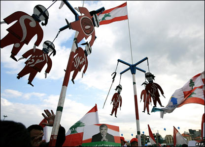 "Cut-outs of hanged figures with the Arabic words ""division"" and ""occupation""."