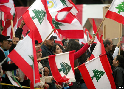 Lebanese wave their country's flag at a ceremony  in Beirut.