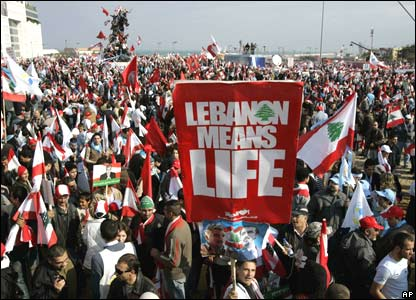 "Demonstrators hold up banner saying ""Lebanon means Life"""