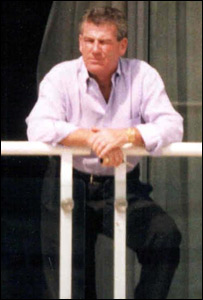 Brian Wright pictured on the balcony of his London flat