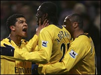 Emmanuel Adebayor celebrates after putting Arsenal ahead