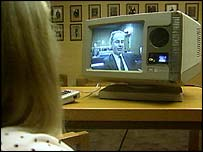 A child looking at a court video link