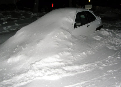 Car buried in snow in Ohio: photo from Tom Chatterton