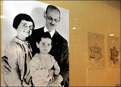 Photo of Anne Frank with her older sister Margot and her father Otto, on display at the YIVO Institute for Jewish Research