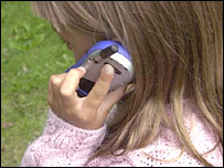 A girl speaks on a mobile phone