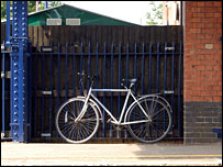 A bicycle chained to railings