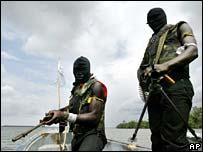 Armed militiamen patrol Delta creeks