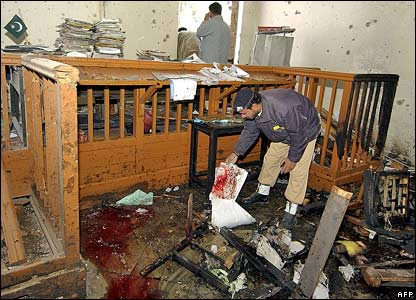 Policeman examines bloodstained documents