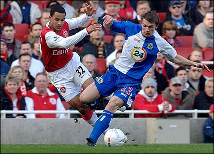 Arsenal's Theo Walcott is tackled by Blackburn's Stephen Warnock