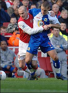Blackburn's David Bentley works hard to deny Freddie Ljungberg