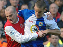 Arsenal's Fredrik Ljungberg and David Bentley of Blackburn