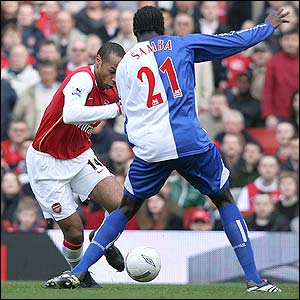 Arsenal's Thierry Henry attempts to get past Christopher Samba