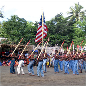Men march at cargo cult ceremony in Tanna