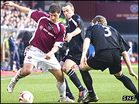 Andrius Velicka is quickly closed down by the St Mirren defence