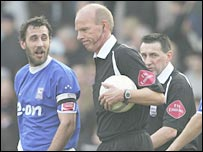 Referee Steve Bennett ignores Ipswich protests