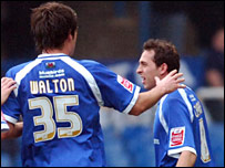 Simon Walton congratulates Cardiff goal-scorer Michael Chopra but both were later sent off