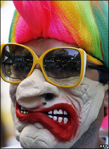 Man with rainbow hair and oversized glasses