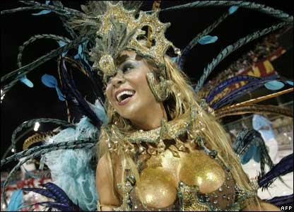 A reveller of the Imperador do Ipiranga samba school parades during carnival celebrations in Sao Paulo