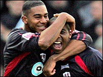 Marvin Elliott [left] celebrates with match-winner Darren Byfield