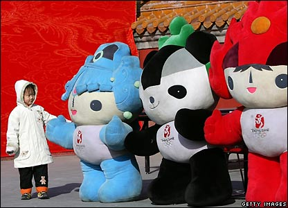 Girl next to giant 2008 Olympics mascots at Ditan Park Temple Fair in Beijing, China