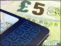 £5 note and credit card