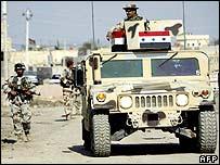 Iraqi soldiers patrol Basra
