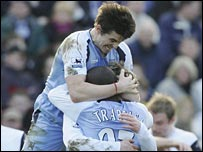 Man City players celebrate Ball's equaliser