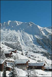 Snow on chalets and mountains in Verbier
