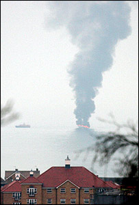 Picture of yacht on fire taken from the shore taken by Paul Ockenden