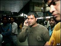 Relatives of people on board the train seek information at Delhi's main station