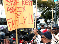Protesters outside the House of Assembly in Nassau, Bahamas