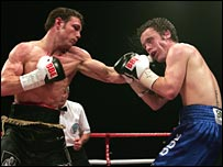 Michael Katsidis (left) lands a big left against Graham Earl.