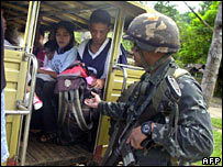 Filipino soldier making security checks in the south