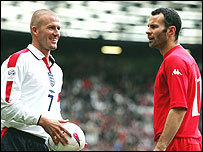 David Beckham shares a joke with Ryan Giggs during an international between England and Wales