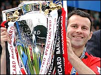 Ryan Giggs poses with the Premiership trophy