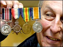 Stuart Davies with his grandfather's medals (photo dailypost.co.uk)
