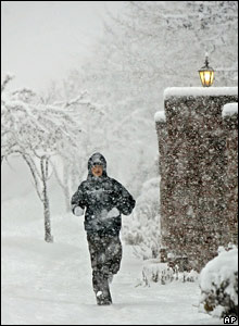A Brigham Young University student jogs in the morning snow outside Rock Canyon in Provo, Utah.
