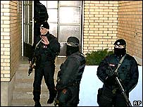 Nato soldiers outside Sasa Karadzic's house