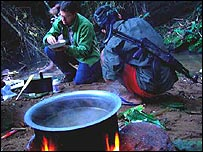 Stefan cooking and eating in the Burmese jungle