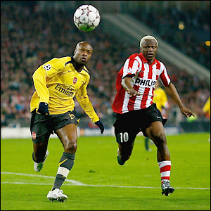 Arsenal's William Gallas and PSV's Arouna Kone contest possession in Holland