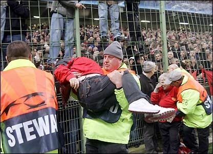 Stewards attend to distressed fans