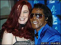 Tomi Rae Hynie with James Brown in November 2006