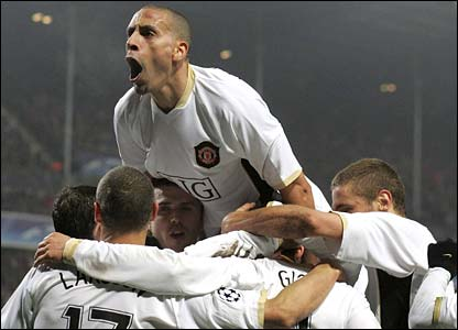 Rio Ferdinand and his team-mates celebrate United's winner