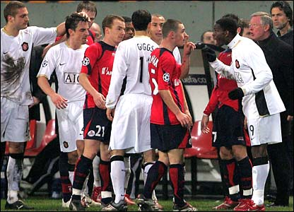 Lille and Manchester United players argue on the touchline