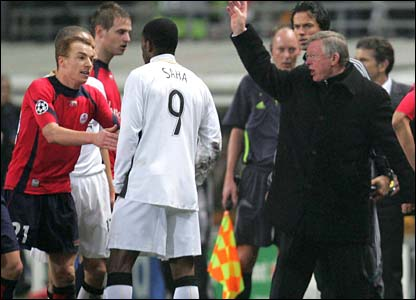Sir Alex Ferguson waves the players back on