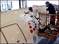 Painters working on plane logo