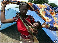 Refugee woman and her child in northern Mozambique