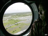 Mozambican army officer looks through a helicopter window as it flies above the flooded area near Caia, northern Mozambique